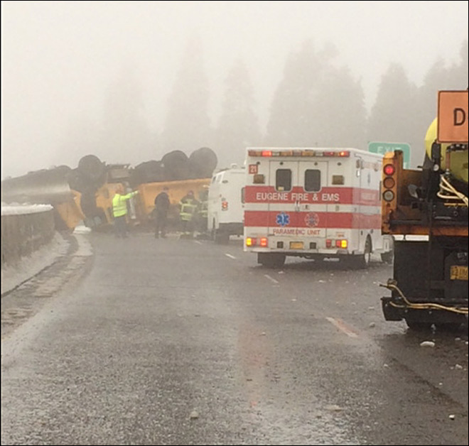 Snow-plow-flips-on-Highway-105---2