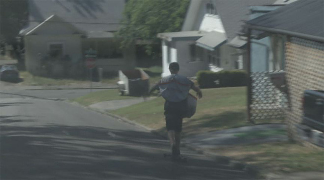 Teen hits hills while longboarding his paper route 03
