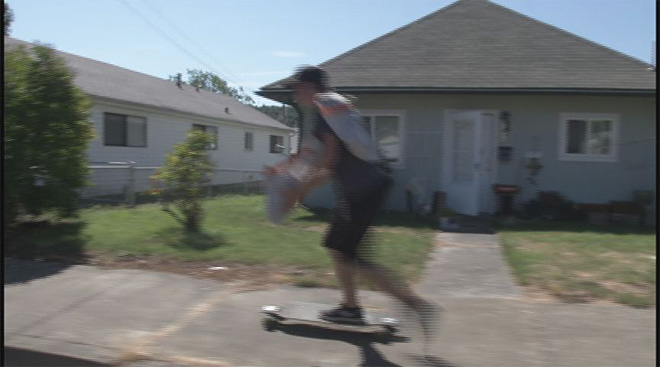 Teen hits hills while longboarding his paper route 05