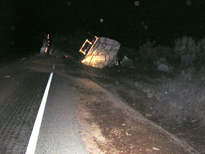 Truck carrying beehives tips along Highway 97