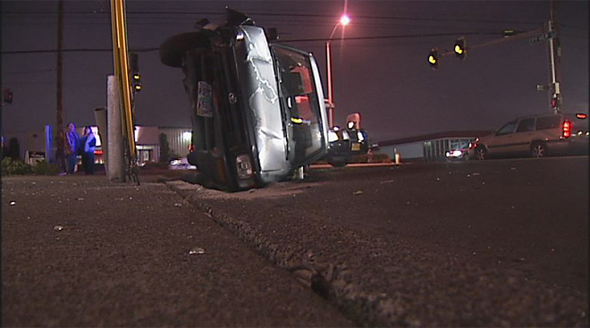 Truck rolls while turning off of W 11th 01