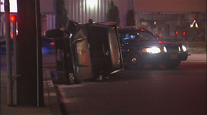 Truck rolls while turning off of W 11th 02