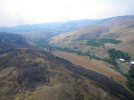 View Of Hillsides And Valley Burned