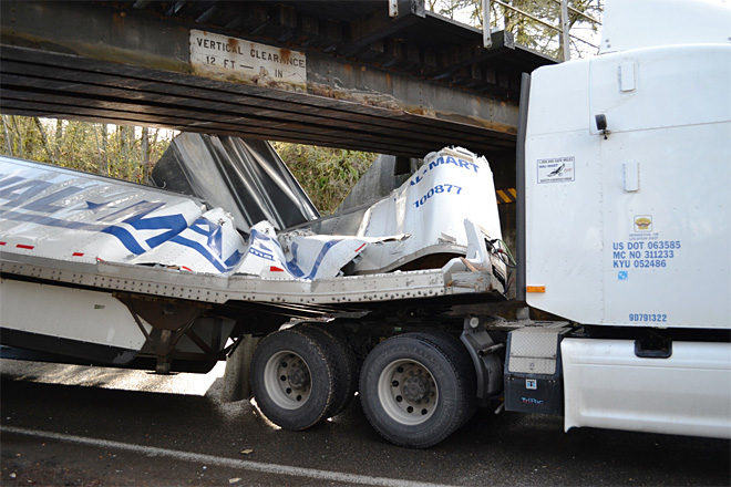 Walmart truck gets stuck under overpass (4)