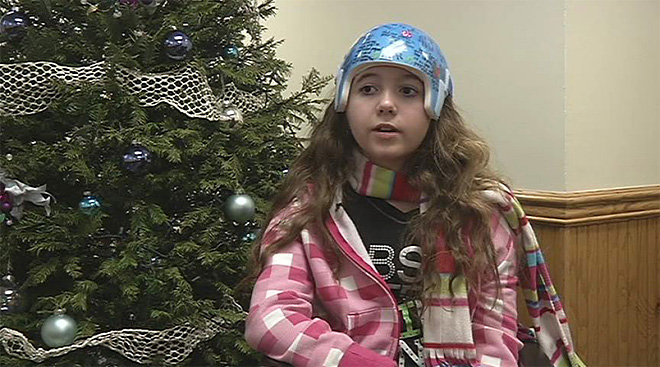 Bandmates surprise hospitalized teen with Christmas performance