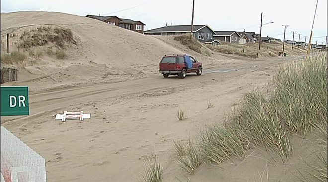 Winter storms bury Waldport homes in sand