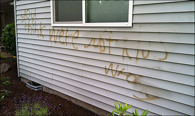 Vandals cut brake lines, graffiti homes at country club in Woodburn