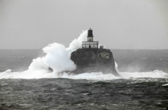 Surf pounds Tillamook Rock Lighthouse