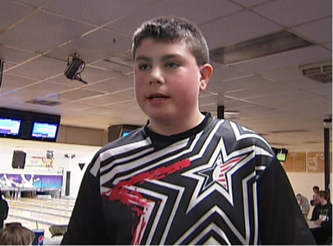 Teen honored for bowling perfect game