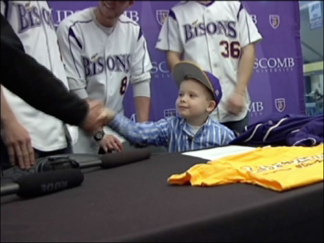 University signs 5-year-old with brain tumor