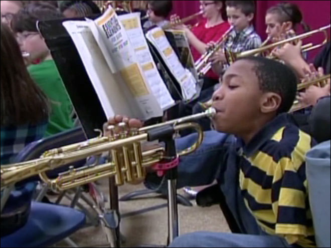 10-year-old plays trumpet with his feet
