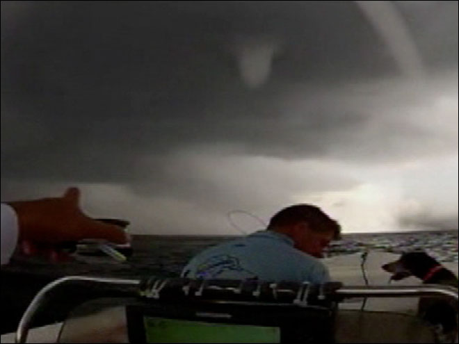 Boaters ride through waterspout