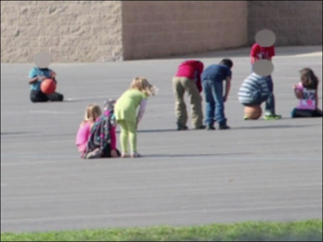 Parents angry over school's hands-on-knees policy