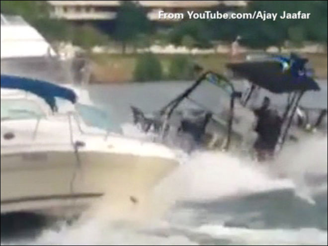 Caught on camera: Police boat hits two docked boats