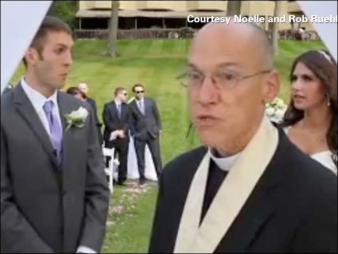 Priest stops wedding over videographers