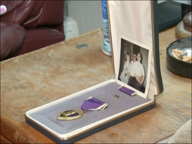 Woman finds Purple Heart inside thrift store purse