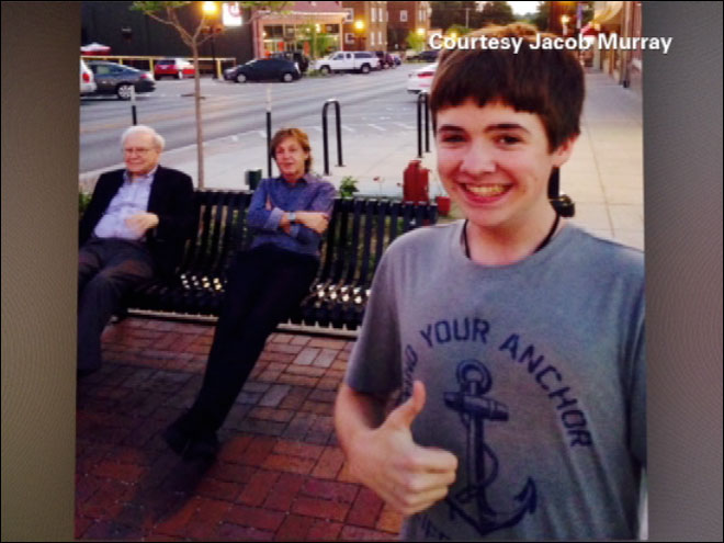 Kid takes selfie with Paul McCartney, Warren Buffet in the background