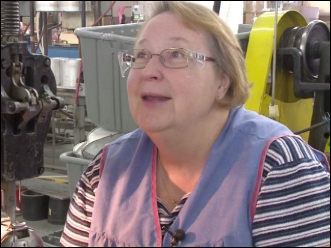Woman has been making footballs for 48 years