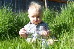 Baby Evan's first playtime in tall grass