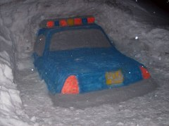 Police Car Carved out Of Snow