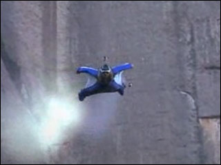 Man wearing a wingsuit takes on batcave