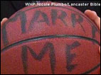 Basketball player proposed to on court