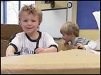 Teacher replaces toys with cardboard boxes