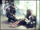 Cop buys shoes for homeless man