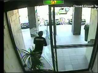 Purse-snatcher faceplants through glass door