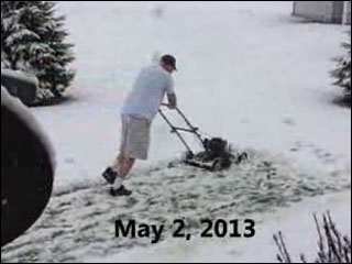 Mayor cuts grass in the snow