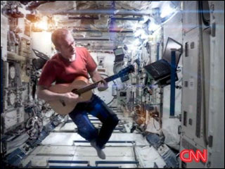 Singing astronaut back on earth
