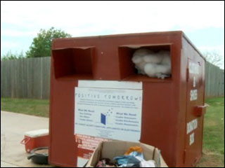 Woman stuck in donation bin calls 911
