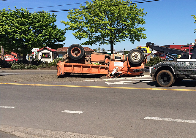 Gravel truck loses brakes and rolls, blocking Roosevelt Blvd. at Hwy 99