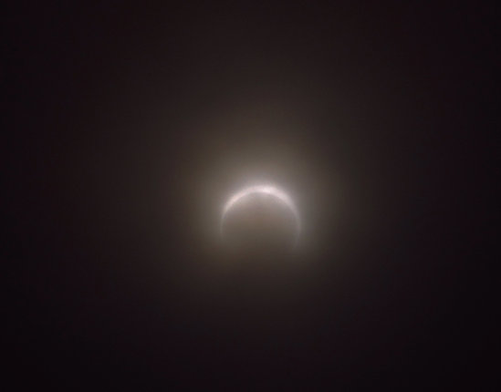 themom51 photo of eclipse through clouds at Winchester Bay