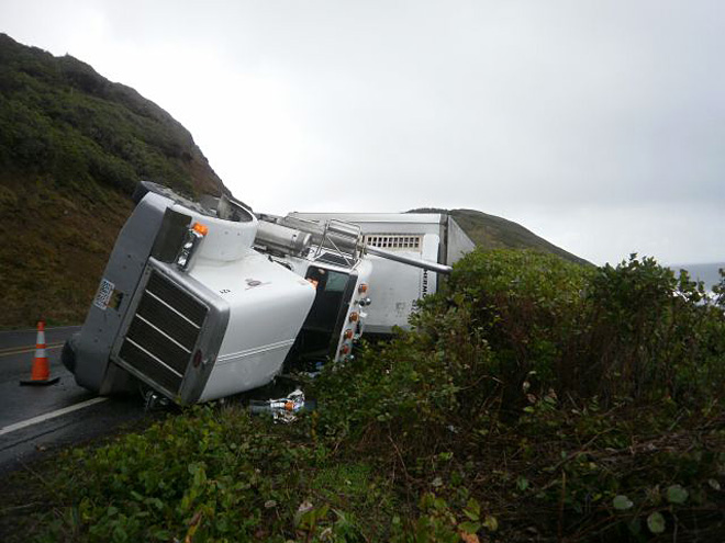 Truck hauling crab pots crashes